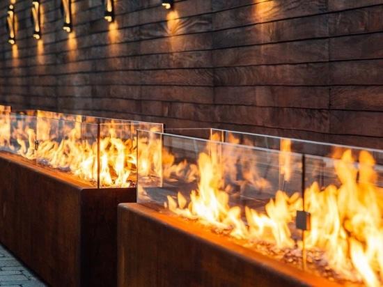 Bespoke 12' Komodo Fire pits in Corten weathering steel with glass barriers.