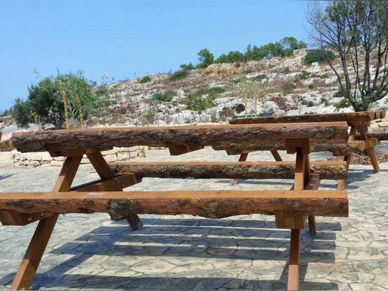 Groups of benches and table made in wood in Malta