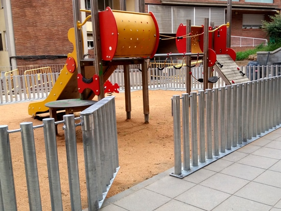 Metallic barrier for playgrounds
