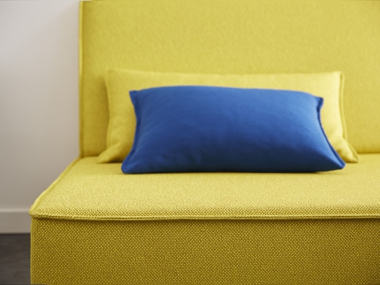 Yellow sofa with blue pillow