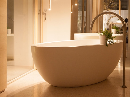 The Giotto freestanding bath spout by Mina in the loft.