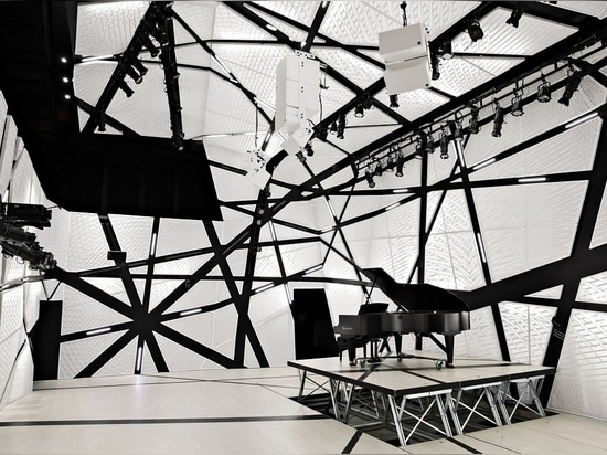 """""""Massive"""" black and white velour drapery surround Brooklyn's music venue, National Sawdust, creating an """"acoustic envelope""""."""