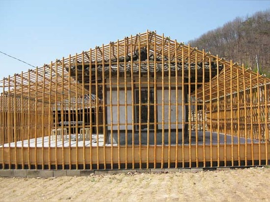 This abandoned 300-year-old home was turned into a cafe wrapped in a bamboo frame