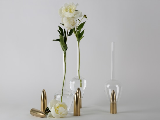 Richard Yasmine's Plugged carafes sit atop phallic brass rods