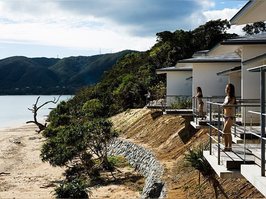 'nest at amami' is a remote japanese beach village built between the sky and the sea