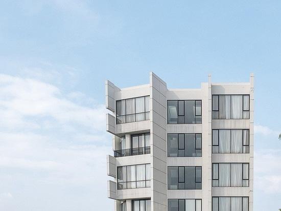 RAW architecture designs a wickering concrete rivoli hotel in the crowded east jakarta