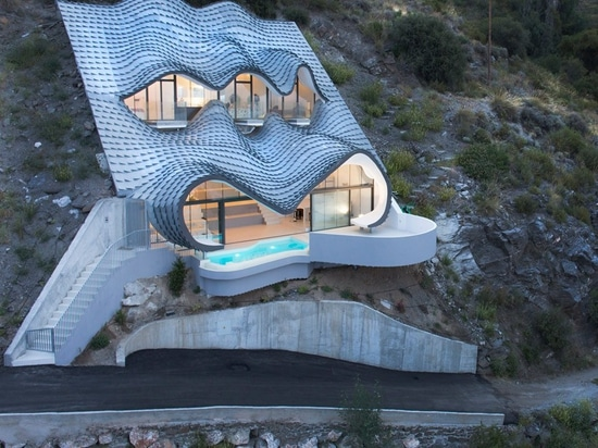 gilbartolomé buries metallic scaled residence into a cliff overlooking mediterrean