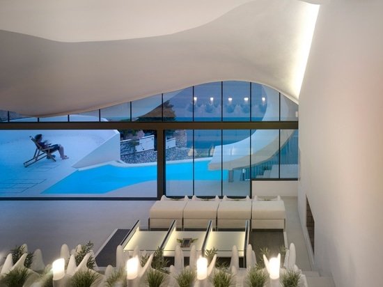 the movable glass facade completely opens to the landscape and onto the terrace and pool area