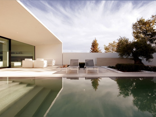 JM Architecture lines L-shaped villa on northern Italian coast with ceramic tiles by Mosa