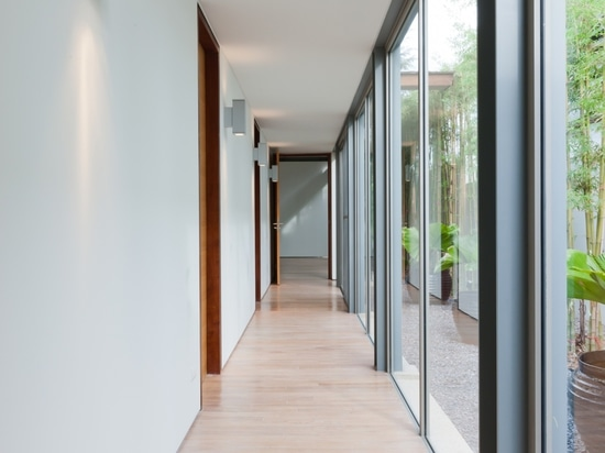 corridor that connects the rooms