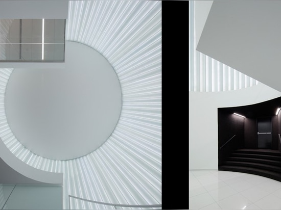 the white walls, floor and ceiling polarize the dark entry funnel