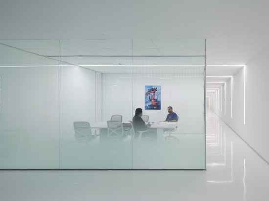 the offices and meeting rooms are all enclosed with glass, acoustic ceilings and carpets