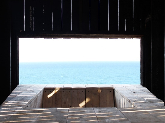 Kieran Donnellan works with students to build tiny clifftop chapel in Lebanon