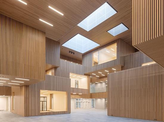 Atrium cladded with Gustafs slats in oak veneer