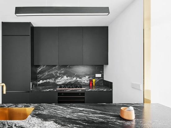 Raúl Sánchez Architects uses black and white to define spaces in Barcelona apartment