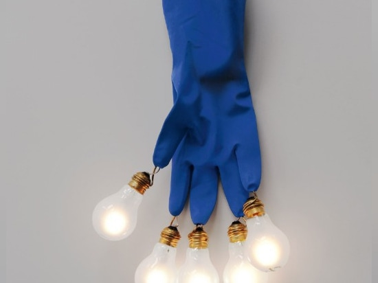 Luzy by Ingo Maurer, the work glove with a bulb at each fingertip