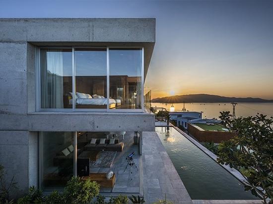 MM++ architects' villa in vietnam uses retractable glass loggia for unique ocean view