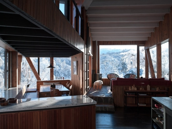 La Dacha Mountain Refuge built from blackened wood in Chilean Andes