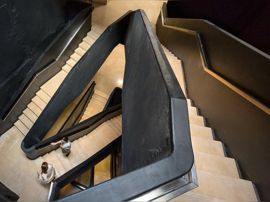 sculptural staircase connects the MSGSSS-renovated museum of modern art in buenos aires