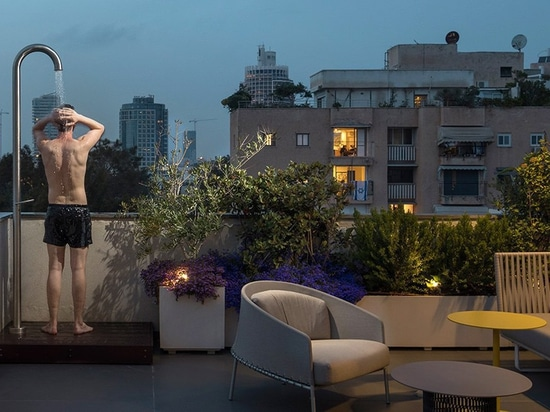 this holiday apartment in tel aviv features open rooftop terrace with shower on it