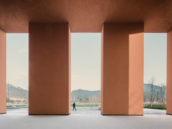 David Chipperfield embeds red natural-history museum into sloping earth