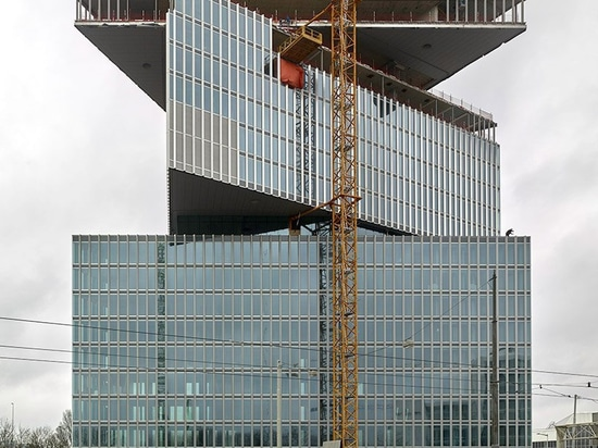 OMA / reinier de graaf's Nhow amsterdam RAI hotel tops out