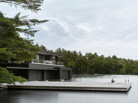 Charred cedar clads Ontario lake boathouse by Akb Architects