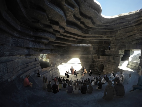 Open Architecture designs Chapel of Sound concert hall to look like hollowed-out boulder