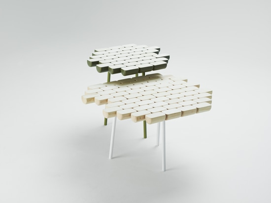 Bit By Bit turns small bits of wood together to create a playful tabletop that is reminiscent of Duplo blocks.