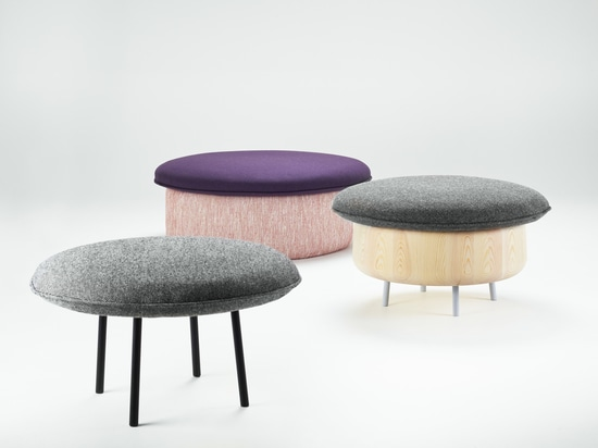 A family of colorful islands for your living room, the Øy series is upholstered in wool fabric and made from pine or coated steel.