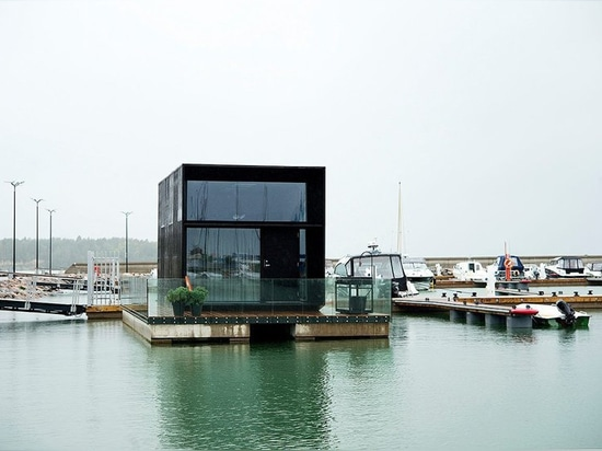 kodasema's tiny prefab house floats on water through integrated pontoons