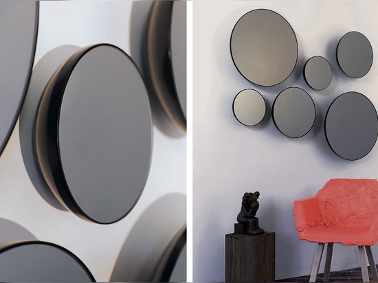 The black powder coated spun metal back of the Black Mirrors gives depth and intrigue to an otherwise flat object.