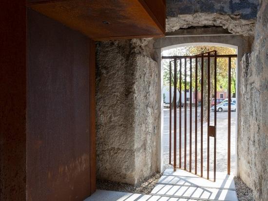 nenad fabijanic inserts a corten steel volume into the remains of a baroque church in croatia