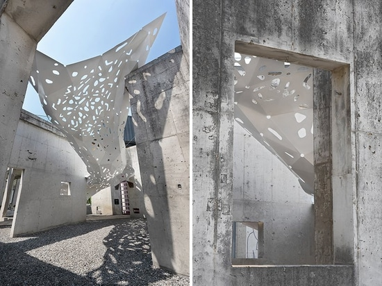 view from the ground / view through an opening in the concrete wall