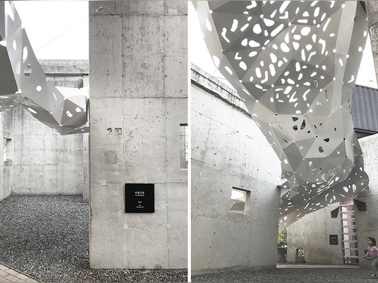 the metal sheets contrast against the exposed concrete walls