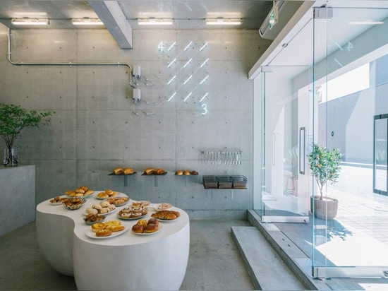 fathom designs japanese bakery ripi as a continuous space of concrete and glass