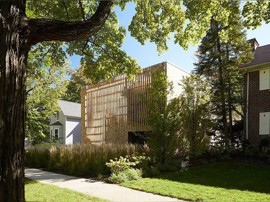 the façade of this house in chicago boasts an array of twisting brick columns