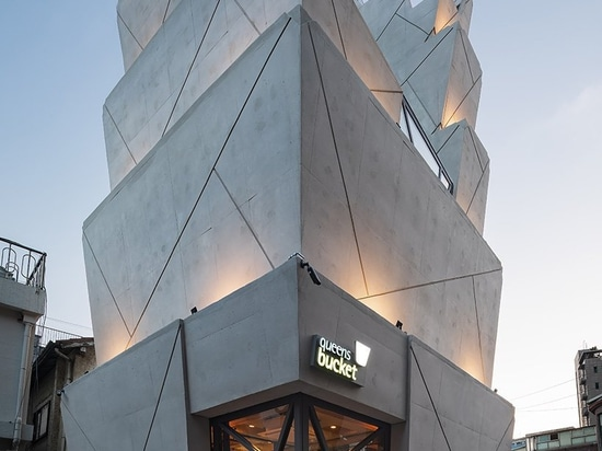 moon hoon manipulates a stack of 'buckets' for sesame oil HQ in seoul