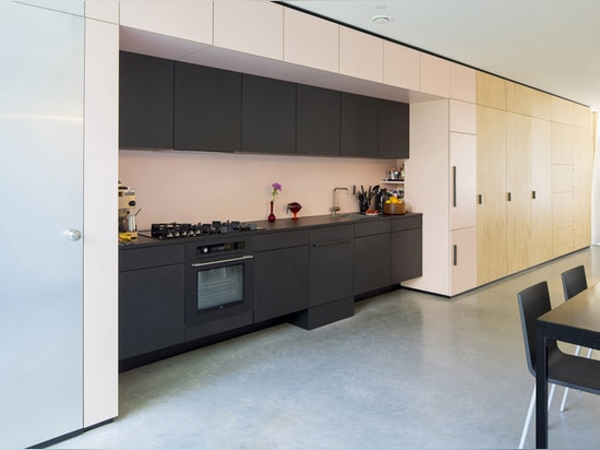 a sanitary pink laminate is used for the kitchen and dining area
