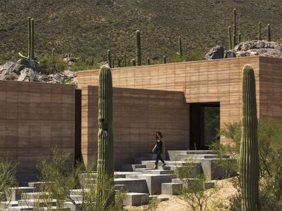 Tucson Mountain Retreat by D U S T, Tucson, Ariz. Located in the mystical landscape of the Sonoran desert, this rammed-earth residence features an isolated carport over 400 feet from the house that...