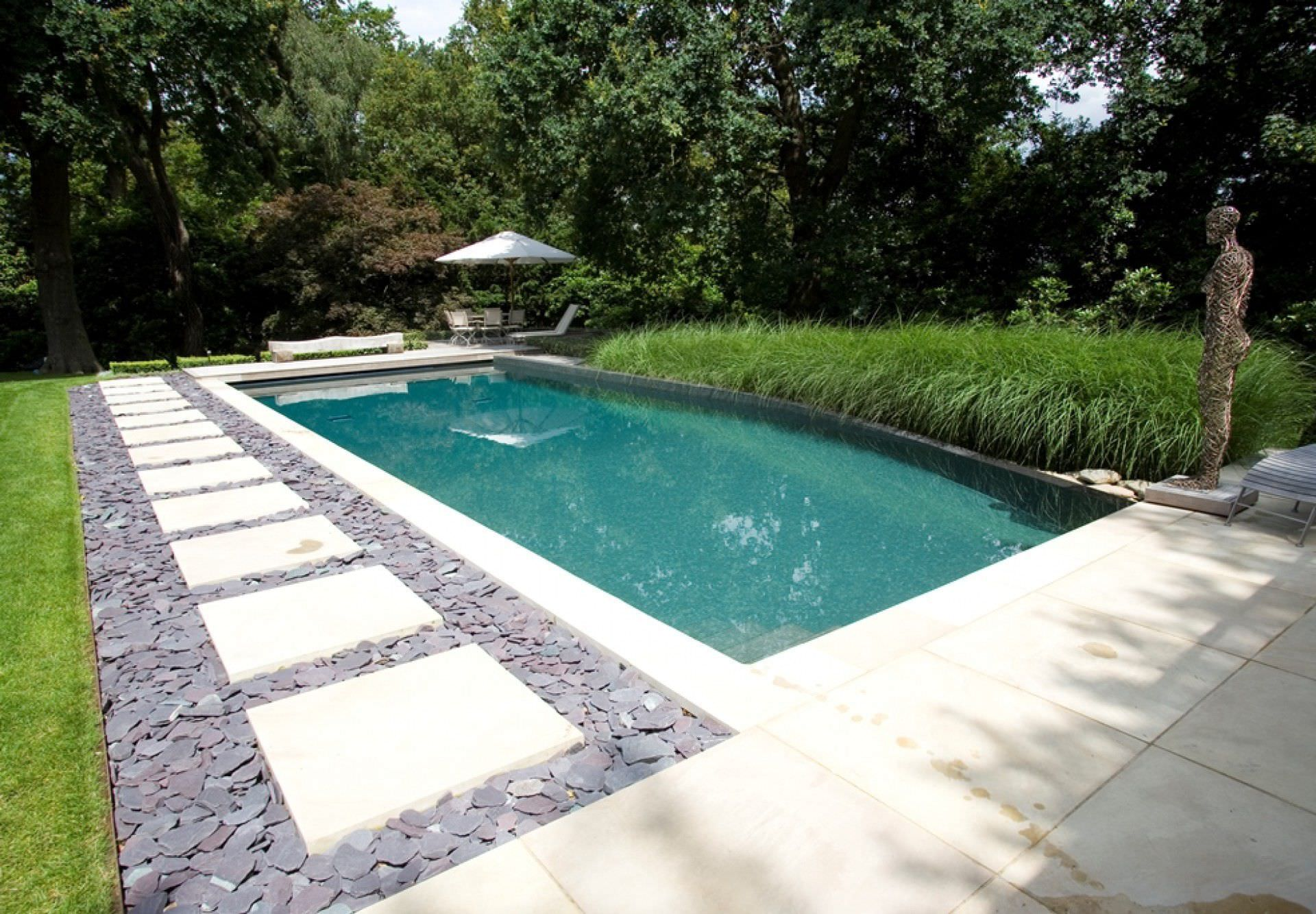 In-ground swimming pool / concrete / natural / outdoor ...