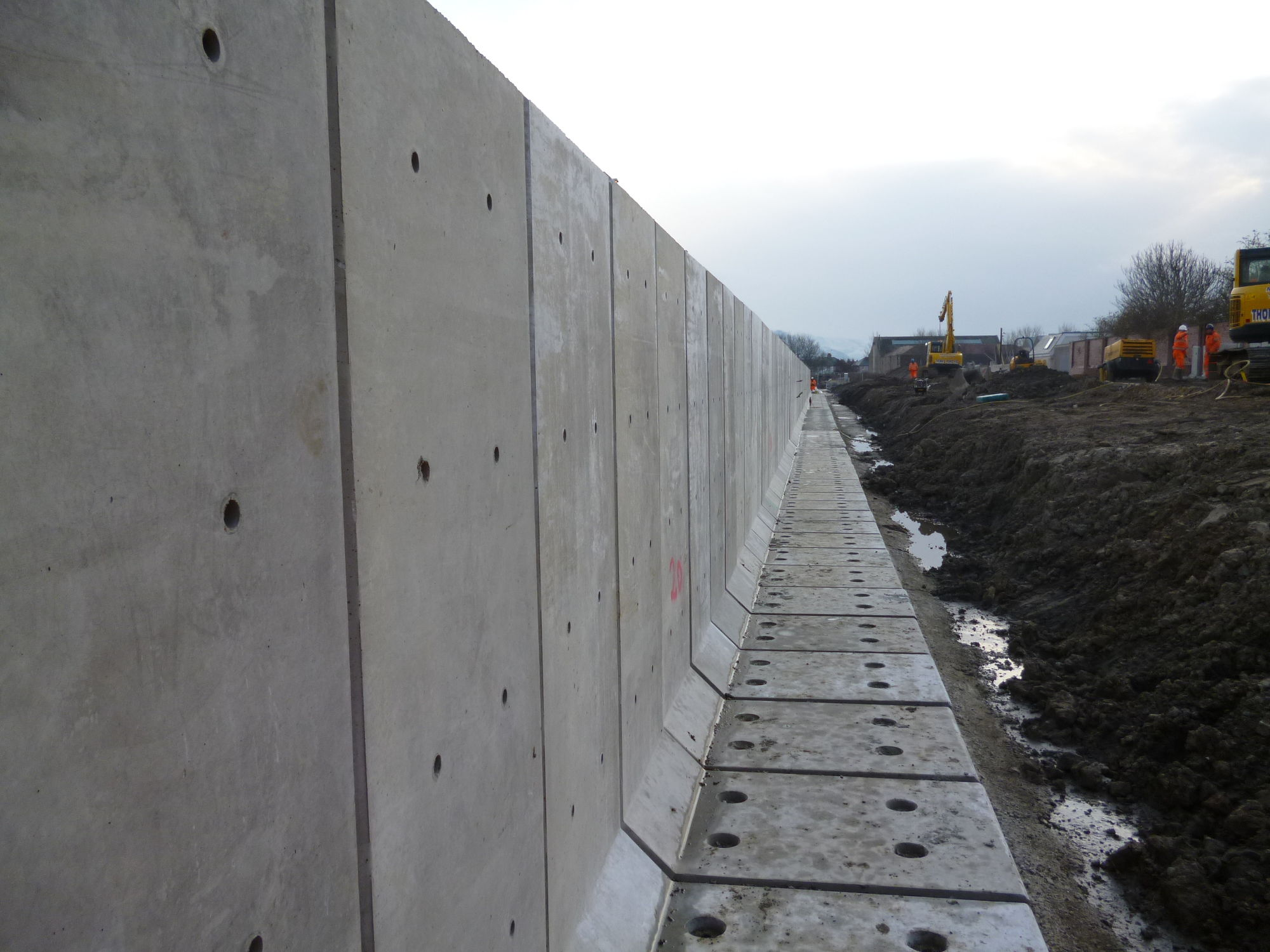 Concrete retaining wall - L SHAPE - CPM Group Ltd - modular / for exterior  fittings / road