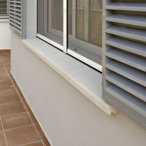 concrete window sill / exterior