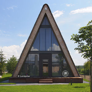 standard model house / contemporary / glue-laminated wood / glass