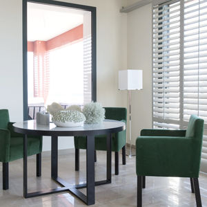 contemporary table / metal / metal base / round