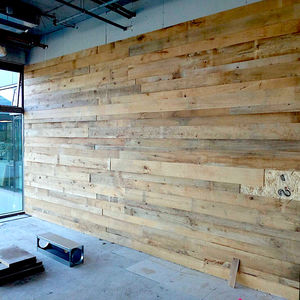 wall-mounted paneling / wooden / recovered materials