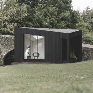 prefab house / modular / minimalist design / timber frame house