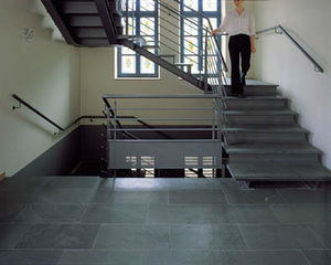 half-turn staircase / metal frame / concrete steps / with risers