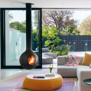 wood heating stove / central / steel / glass