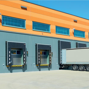 sectional industrial doors / steel / automatic / thermally-insulated